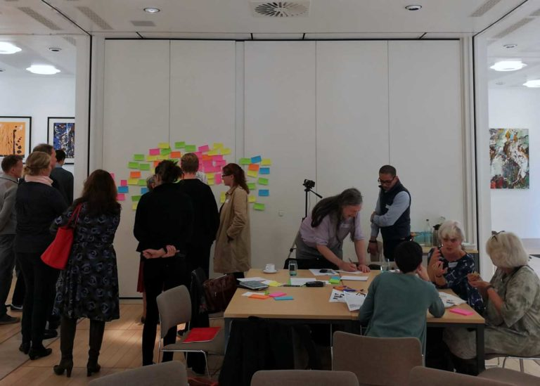 Participants inspecting and discussing the post-its