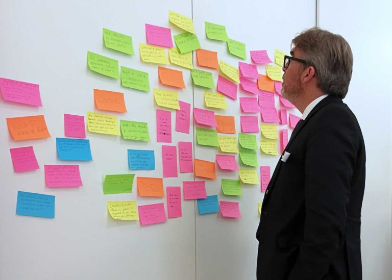 Participant inspecting the post-its